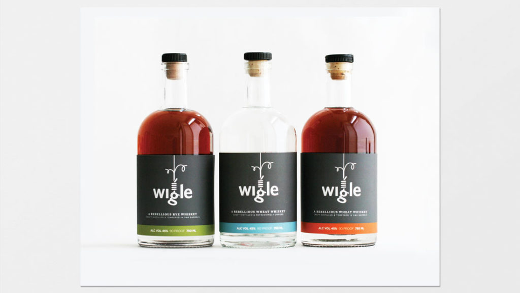 three wigle whiskey bottles
