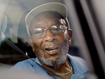 Harold in a car