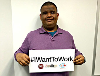 guy holding a I want to work sign