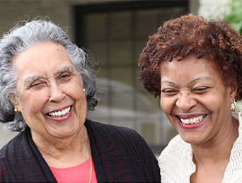 two seniors laughing