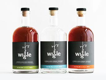 three wigle whiskey bottles