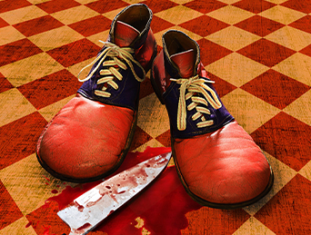 Pagliacci: Clown shoes with bloody knife